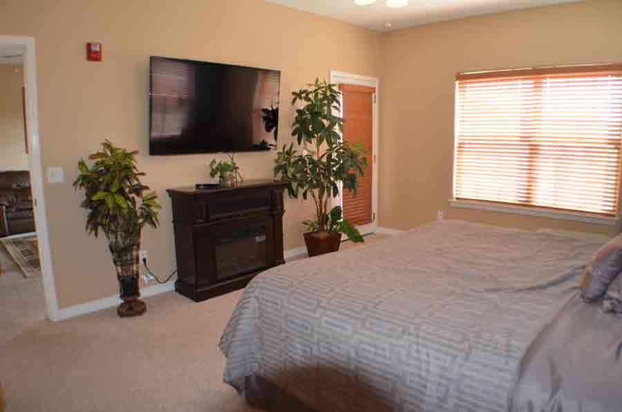 Master-bedroom-with-60-inch-television