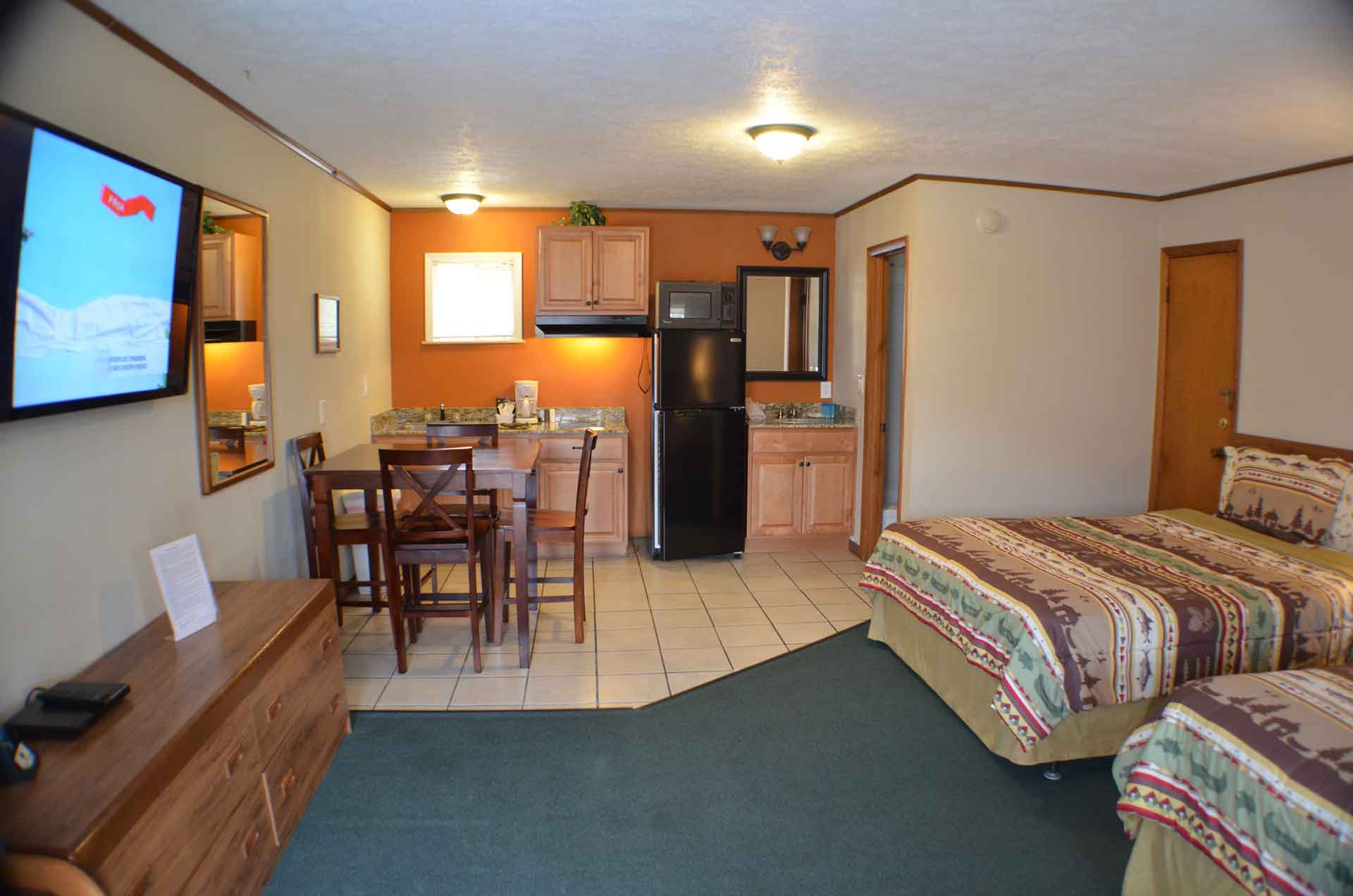 Photo showing the interior of room 12 which is an extended stay kitchenette. Many of our guests rent these when they come to Branson on vacation for 5 to 7 nights.