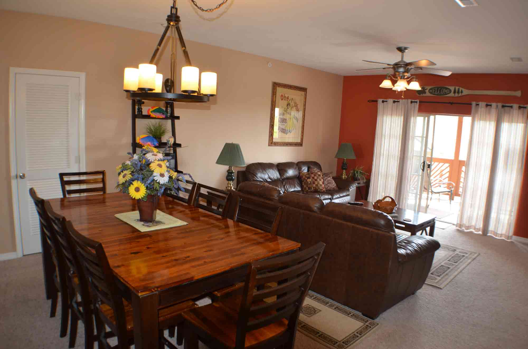 There is an 8 person dining table along with 2 hideabed couches in the living room of this condo.