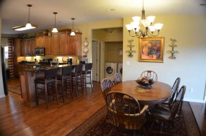 Interior shot of Rockwood 13s condo showing the dining table and kitchen