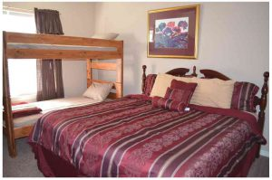The second bedroom comes with a set of bunk beds and a king sized bed