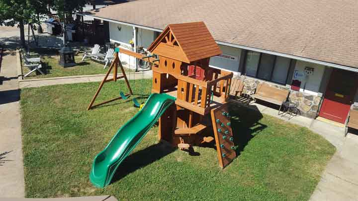 Our playground features a climbing wall, large slide and swings