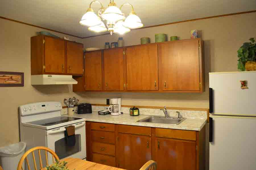 Kitchen-comes-complete-with-a-full-array-of-utensils,-cookware,-pots,-pans,-and-dishes